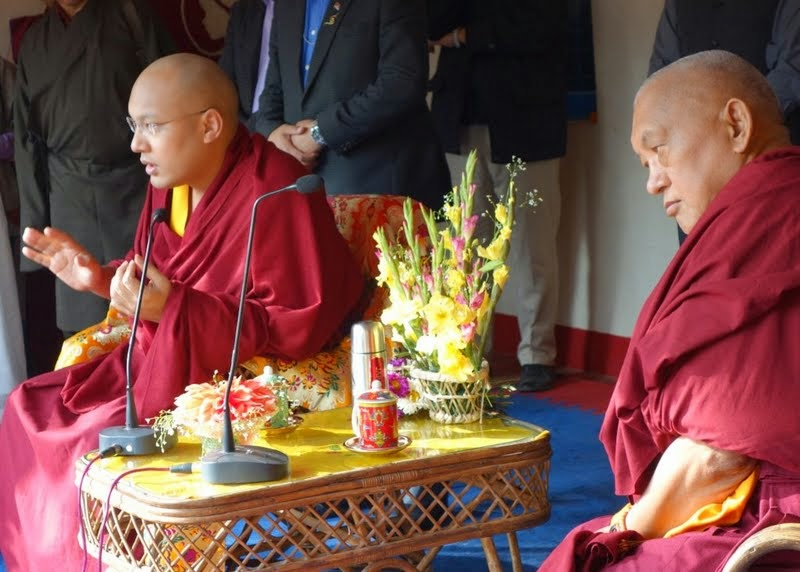 His Holiness the Karmapa and Lama Zopa Rinpoche during a talk to the students and staff of Maitreya School, Root Institute, Bodhgaya, India, January 2014. Photo by Ven. Roger Kunsang.