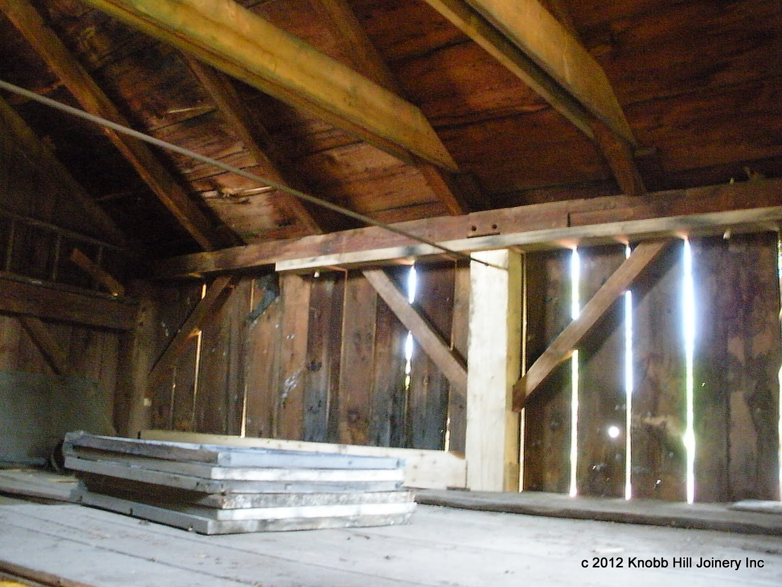 The beech lintel supports the scarf joint and the plate.