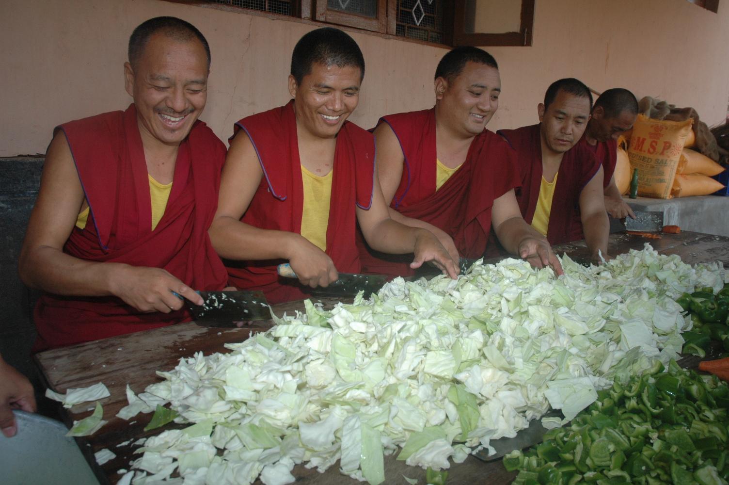 The monks prepare vegetables.