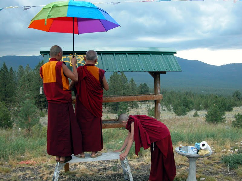 Ven.Sangpo, Lama Zopa Rinpoche and Ven.Angie at Buddha Amitabha Pure Land, WA. Rinpoche is writing mantras above bird feeder house, to bless the birds when they eat