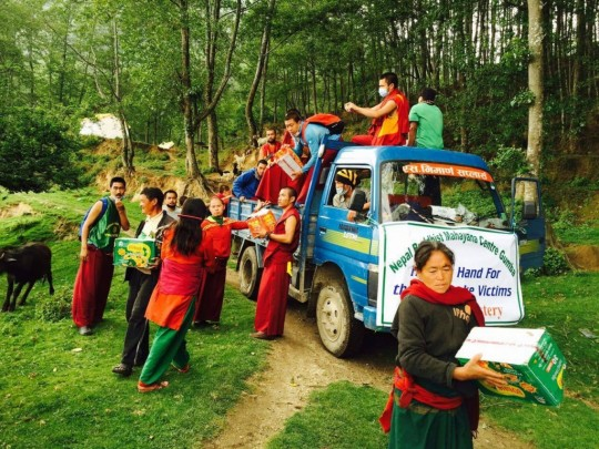 Distribution of food supplies to villagers.