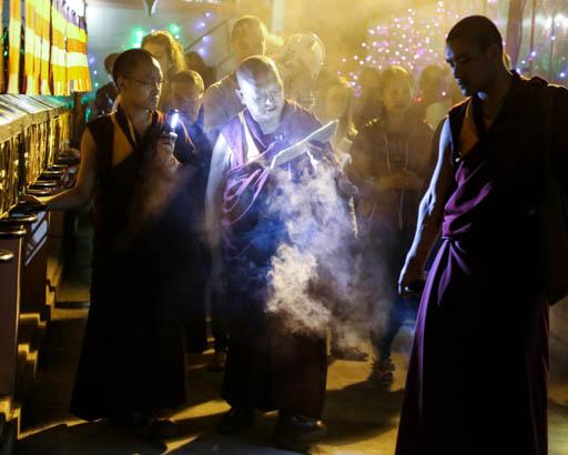 Lama Zopa Rinpoche circumambulating the Mahabodhi Stupa at night, Bodhgaya, India, February 2015. Photo by Ven. Thubten Kunsang.