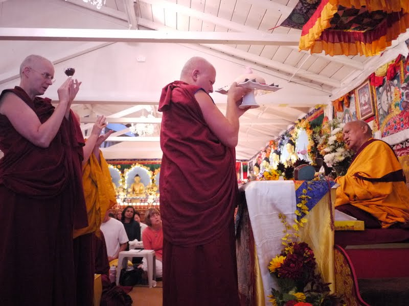 Offering tsog to Lama Zopa Rinpoche at Land of Medicine Buddha