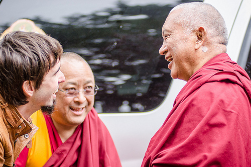 Tenzin Ösel Hita greeting Lama Zopa Rinpoche with Ven. Pemba Sherpa in the background, Land of Medicine Buddha, California, September 21, 2013. Photo by Chris Majors.