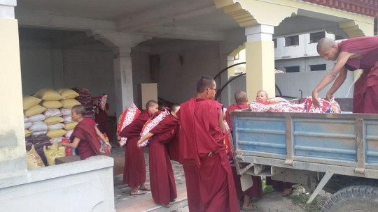 Kopan nuns loading a truck bound for Rasuwa District, Nepal, May 2015.