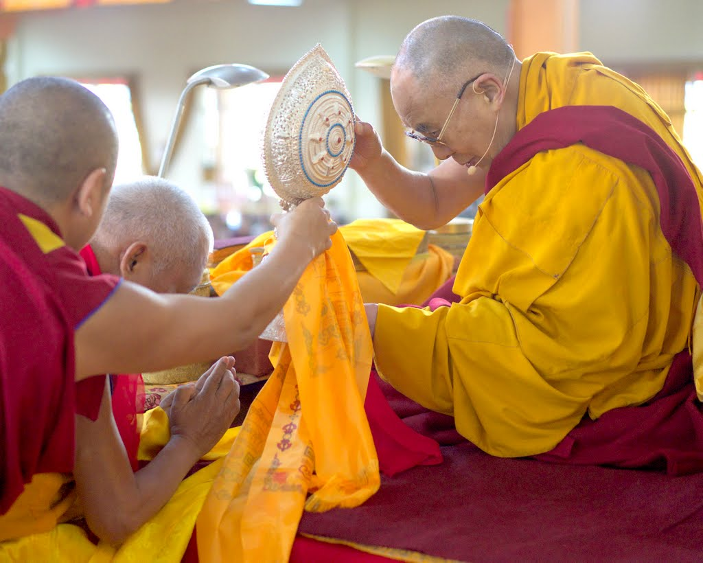 Lama Zopa Rinpoche offering Dharmachakra to His Holiness the Dalai Lama during Jangchub Lamrim teachings at Gaden Monastery, India, December 2014. Photo by Bill Kane.