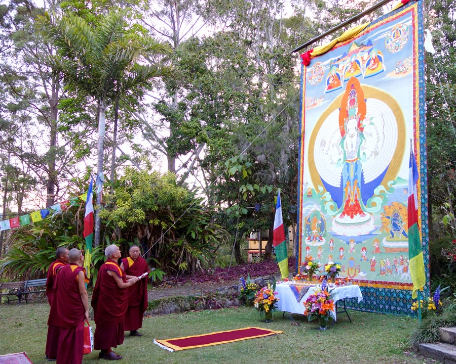 Lama Zopa Rinpoche viewing the large Chenrezig thangka at Chenrezig Institute, Australia, September 2014. Photo by Ven. Roger Kunsang.