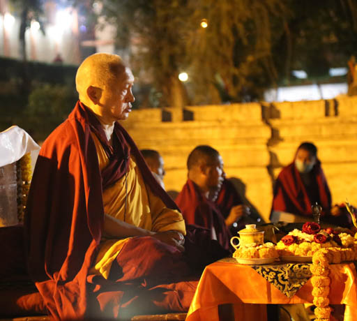 Lama Zopa Rinpoche offering 1,000 tsogs at Mahabodhi Stupa at night, Bodhgaya, India, February 2015. Photo by Ven. Thubten Kunsang.
