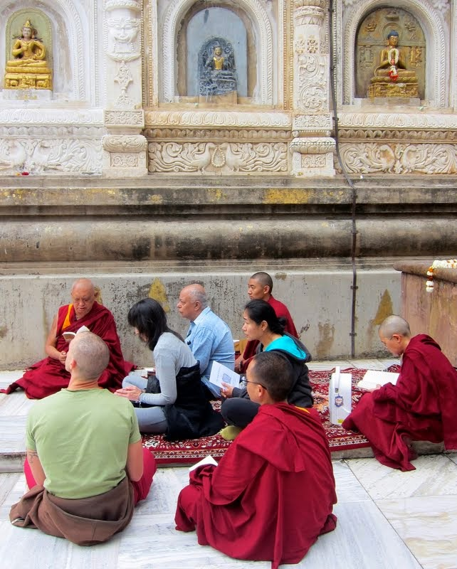 "Lama Zopa Rinpoche giving an oral transmission of ""King of Prayers"" at Mahabodhi Stupa, Bodhgaya, India, February 2014. Photo by Ven. Sarah Thresher."