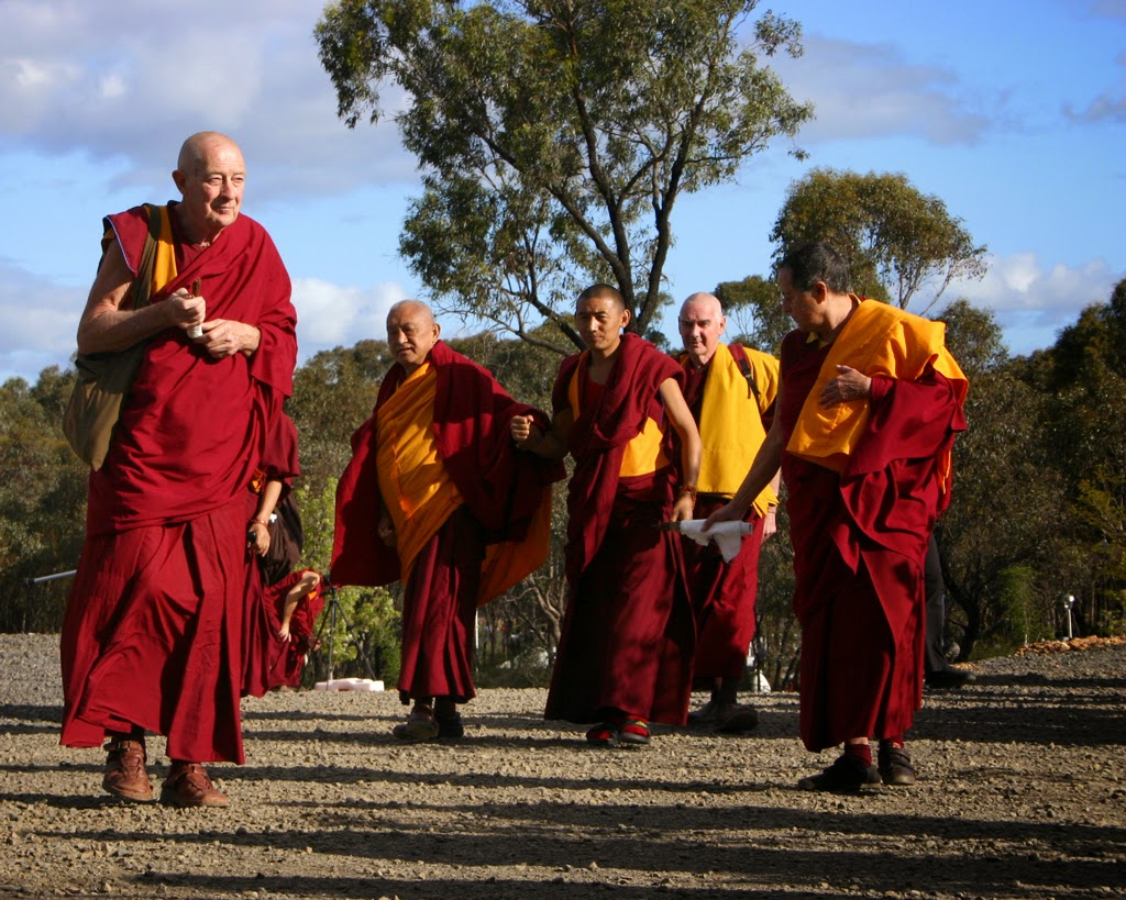 Lama Zopa Rinpoche with Ven. Gyatso (left) arriving at Great Stupa of Universal Compassion during retreat, Australia, October 2014. Photo by Cynthia Karena.