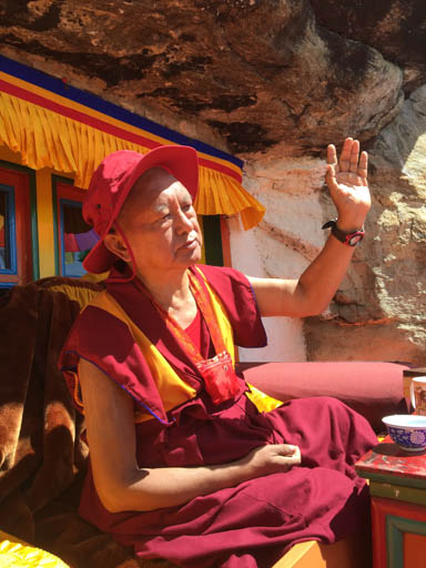 Lama Zopa Rinpoche teaching outside his cave at Lawudo Retreat Centre, Nepal, April 2015. Photo by Ven. Roger Kunsang.