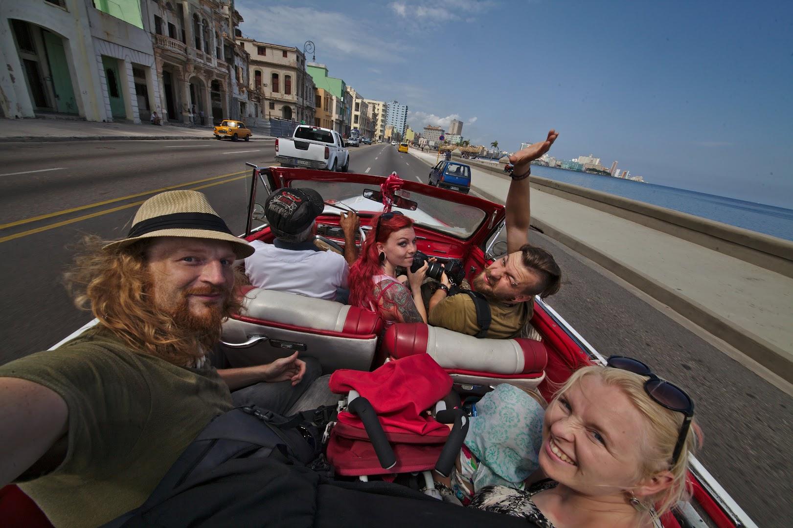 Compulsory touristy open-top ride along Malecón, Havana