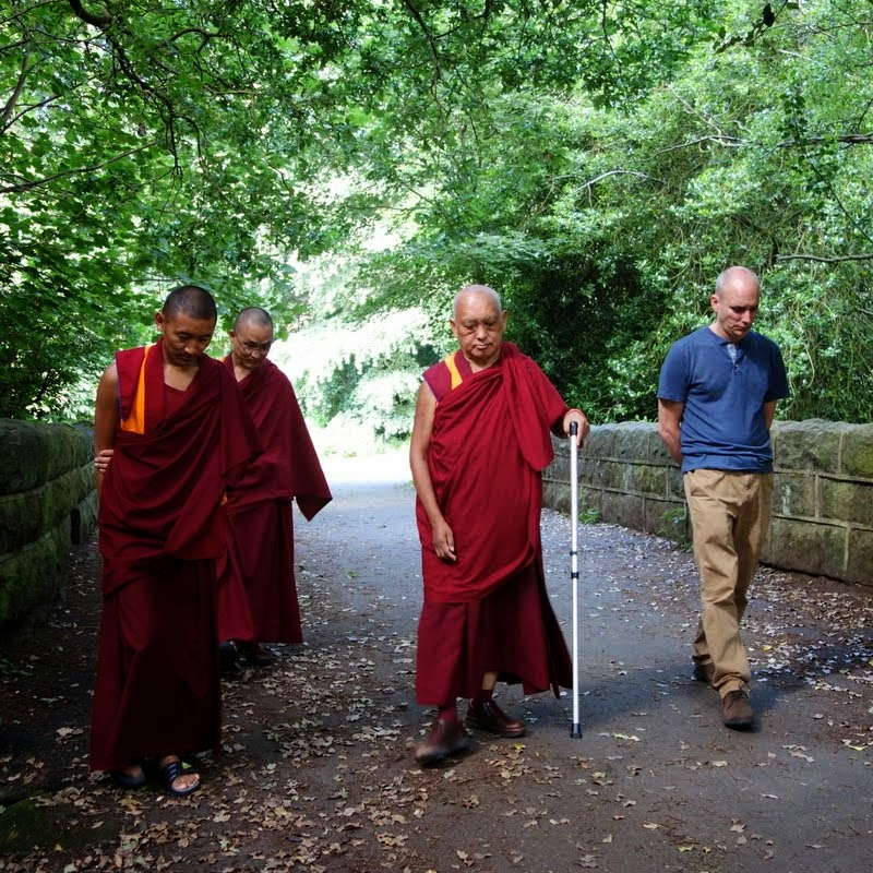 Lama Zopa Rinpoche taking a walk in the park on his first morning in England, July 1, 2014. Photo by Ven. Roger Kunsang.