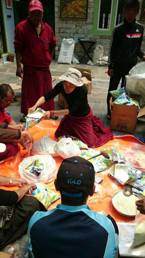 Charok Lama helping prepare second shipment of emergency aid for villages in Upper Solu Khumbu, Nepal, May 2015. Photo courtesy of Charok Lama.
