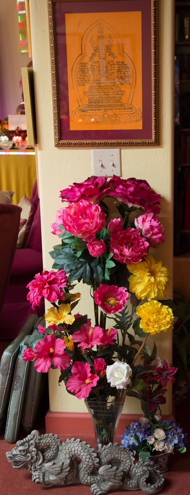 Flowers offered to mantra. Photo by Ven. Thubten Kunsang.