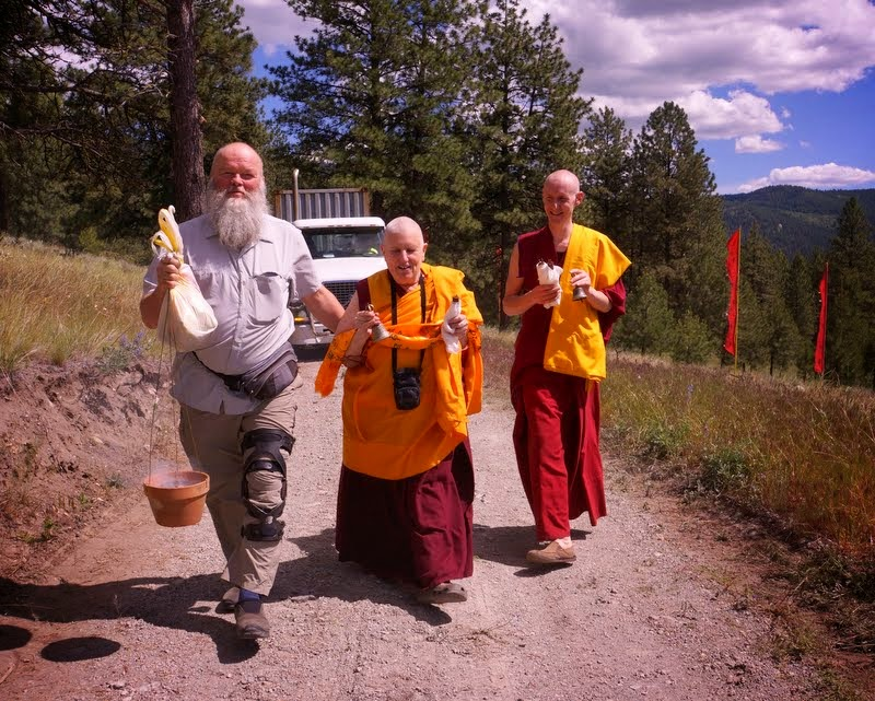 Vens. Wangmo and Tarchin and Harry Sutton walk in front of the truck carrying the Amitabha Buddha statue, which took two years to realize, at Buddha Amitabha Pure Land, Washington, US, June 30, 2014. Photo by Merry Colony.