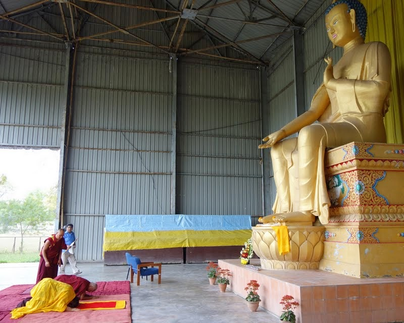 Tai Situ Rinpoche and Lama Zopa Rinpoche making prostrations in front of the 24-foot (7-meter) Maitreya Buddha statue on Maitreya Project land in Bodhgaya, India, March 2014. Photo by Ven. Roger Kunsang.