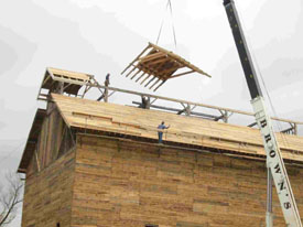 Flying in roof sections.  This photo came from the VYCC web site.