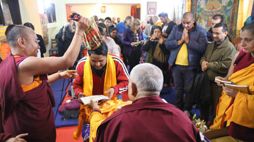 Lama Zopa Rinpoche blessing students with bag filled with mantras at Tushita Mahayana Meditation Centre, Delhi, January 2015. Photo by Ven. Thubten Kunsang.