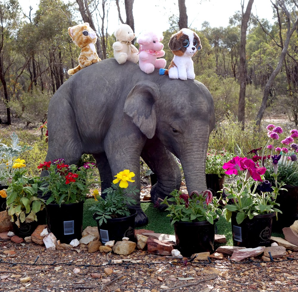 Elephant with friends and offerings near the Great Stupa of Universal Compassion, Australia, October 2014. Photo by Ven. Roger Kunsang.