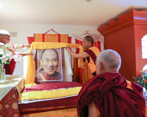 Lama Zopa Rinpoche offers a khata to a portrait of His Holiness the Dalai Lama with Geshe Samten, Sydney, Australia, June 2015.