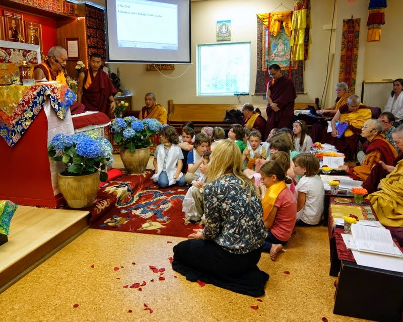 Lama Zopa Rinpoche speaking to the children of Kadampa Center, Raleigh, North Carolina, US, May 3, 2014. Photo by Ven. Roger Kunsang.