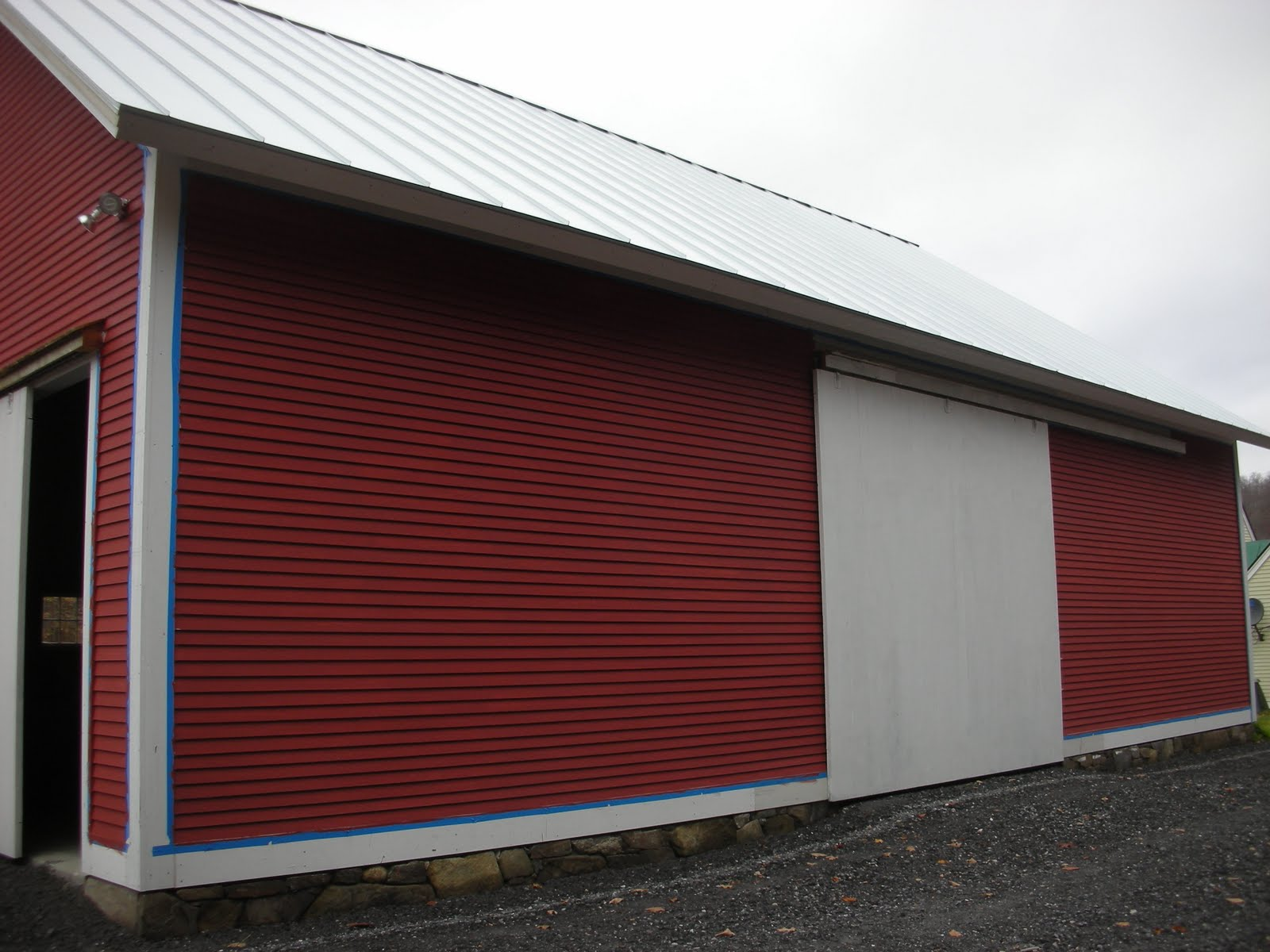 Since we finished this project the family has begun to paint their barn.  One coat down....