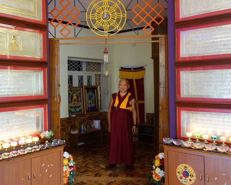 Lama Zopa Rinpoche with framed Heart Sutra carved in gold letters on large silver plates hanging on the walls, which will go into the heart of the Maitreya statue, Osel Labrang, Sera Je Monastery, India, January 2014. Photo by Ven. Roger Kunsang.