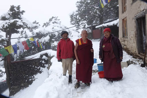 Lama Zopa Rinpoche with his sister Ani Ngawang Samten going to feed the cows at Lawudo Retreat Centre, Nepal, April 2015. Photo by Ven. Roger Kunsang.