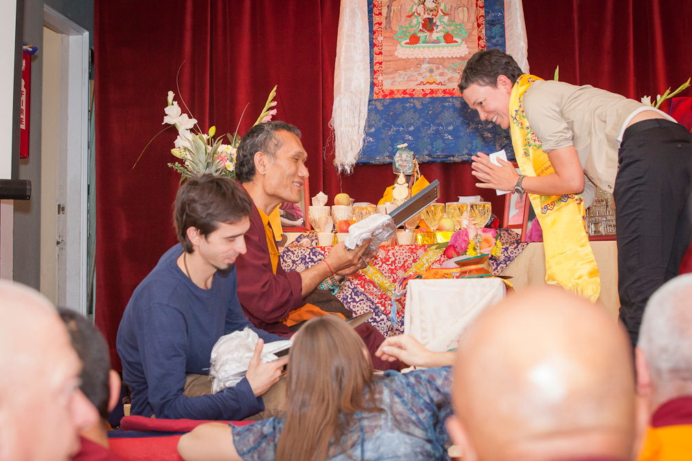 Fabienne offering a gift to Osel and Yangsi Rinpoche Sep 2012