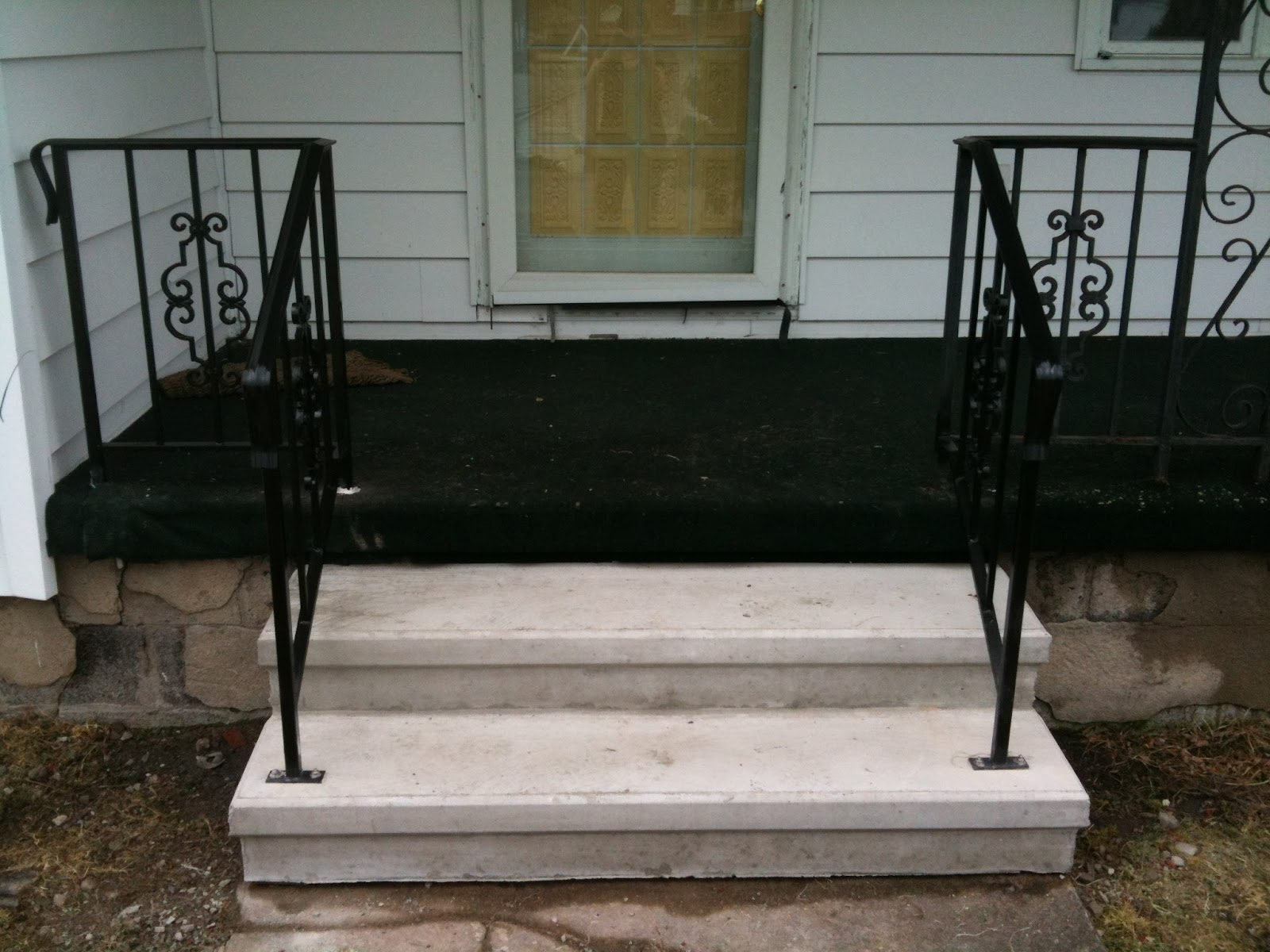 Replaced the front porch steps and railing. The company I used took the old railings and cut off the detail piece, sandblasted it and welded it onto the new railing so it would match the rest of the porch. It came out so nice.