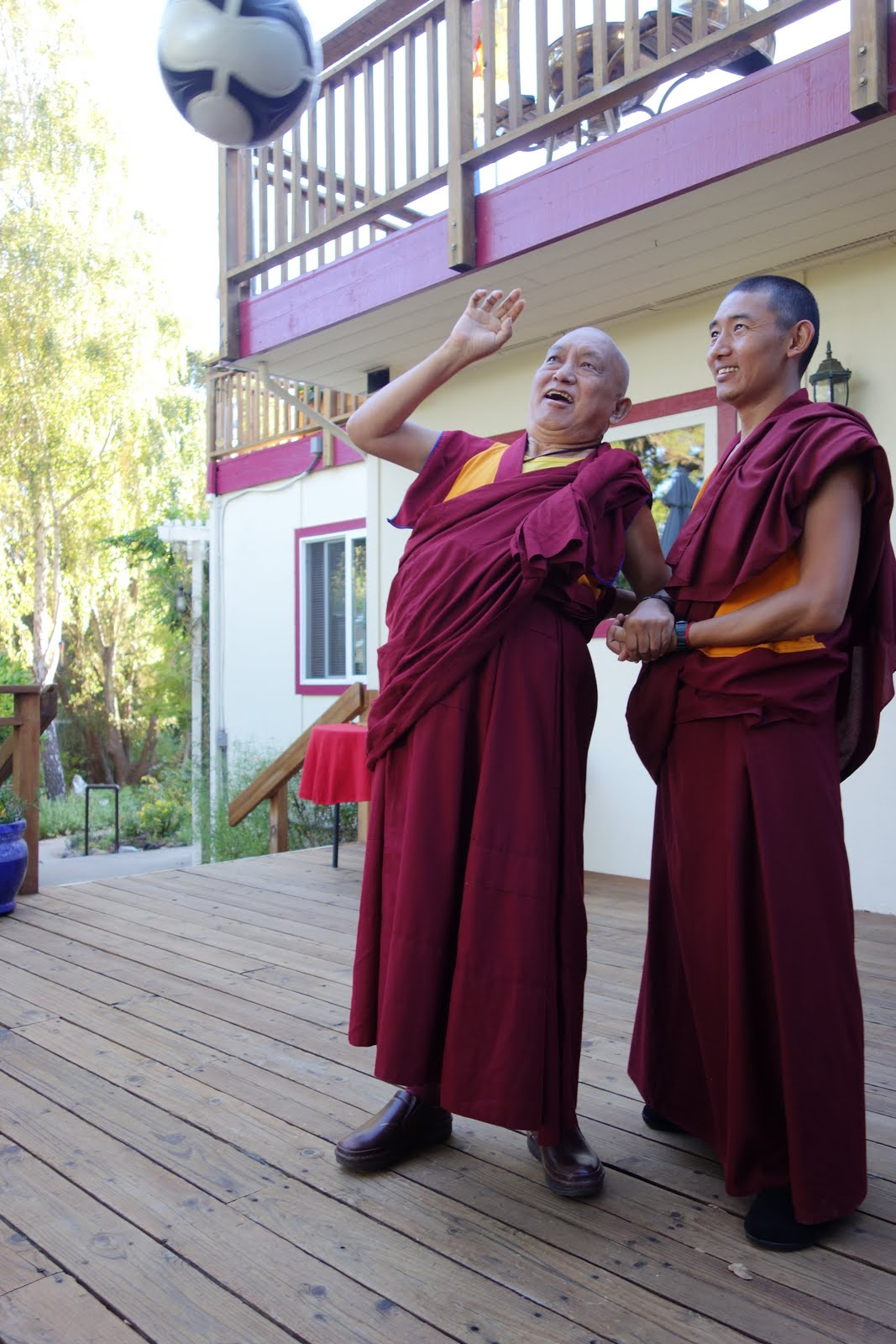 Rinpoche getting some exercise with the assistance of Ven. Sangpo.