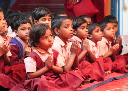 Students at Maitreya School listen to Lama Zopa Rinpoche, Bodhgaya, India, March 2015. Photo by Ven. Roger Kunsang.