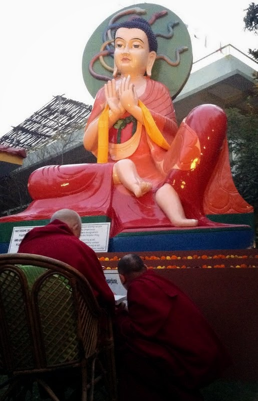 "Lama Zopa Rinpoche reciting ""Hymn to the World Transcendent One"" by Nagarjuna. The Nagarjuna statue was built for Lama Zopa Rinpoche's long life a few years ago, Root Institute, Bodhgaya, India, February 2014. Photo by Ven. Sarah Thresher."