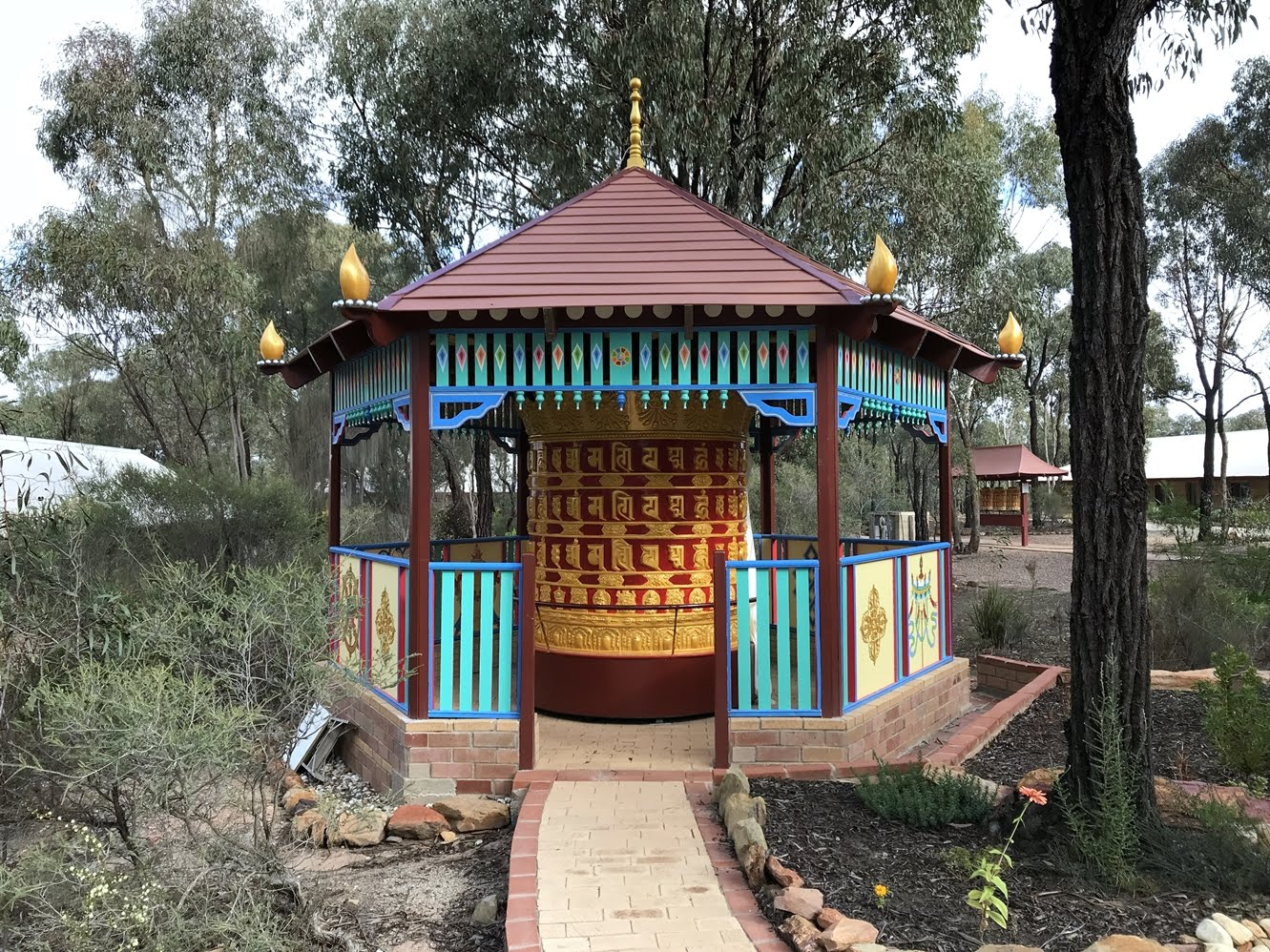 Thubten Shedrup Ling Monastery, Australia. 1.8 meters tall x 1.8 meters diameter contains approximately 250,000,000 mantras including copies of the Dharmakaya Relic Mantras.