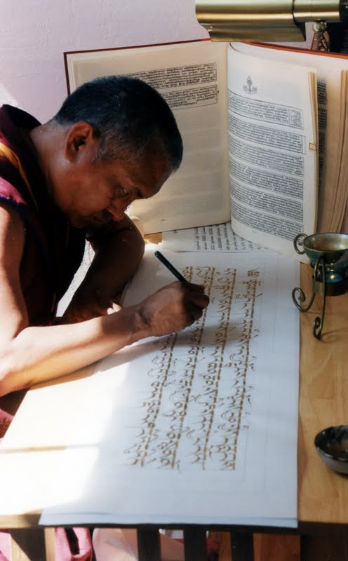Lama Zopa Rinpoche writing the Prajnaparamita in gold