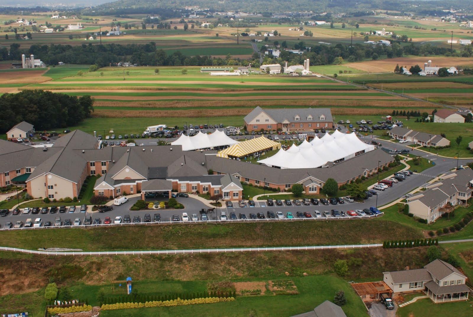View of Wheat Ridge campus from a helicopter on the annual Benefit Auction and Chicken Barbecue day