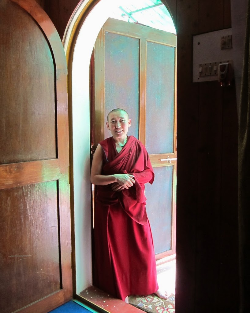 Nun from Tara Nunnery, a project of Kopan Nunnery, in Sarnath, India, March 2014. Photo by Ven. Sarah Thresher. The nuns at Tara Nunnery recite Tara prayers 24 hours a day and have been continuously doing this for over 3 1/2 years.