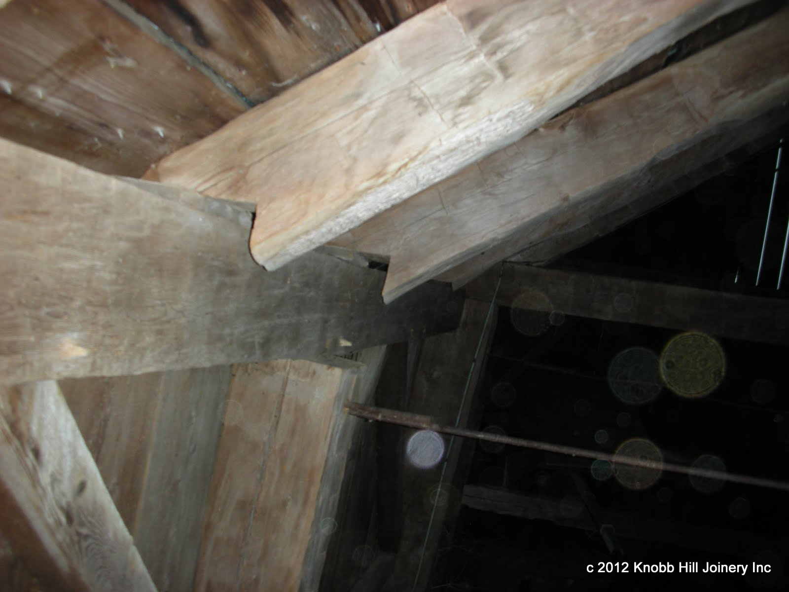 When we had first visited the barn, we thought that the gaps between the rafters and the plates were due to the spreading of the barn.  As it turned out, the original cutting of the rafters and tie beams had not taken into account the two inch cantilever of each plate for the boarding groove.