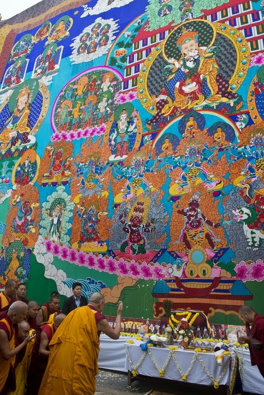His Holiness the Dalai Lama blessing the thangka, Sera Monastery, India, December 29, 2013. Photo copyright Rio Helmi/Jangchup Lamrim Teaching Organizing Committee.