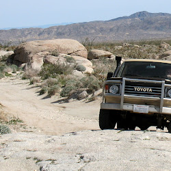 "Betsie the HJ60 climbs the ""4-Wheel Drive only"" obstacle heading towards the trail head."