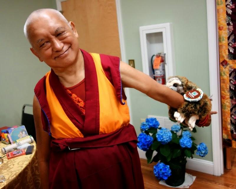 Lama Zopa Rinpoche with a new friend, Black Mountain, North Carolina, US, May 2014. Photo by Ven. Roger Kunsang.