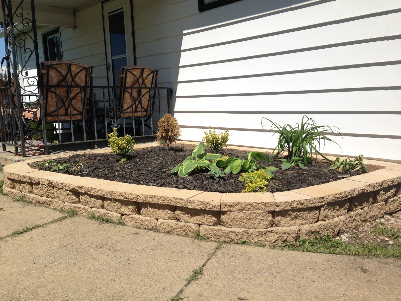 Here's another raised garden bed made from the same stone in the front (slightly different color)