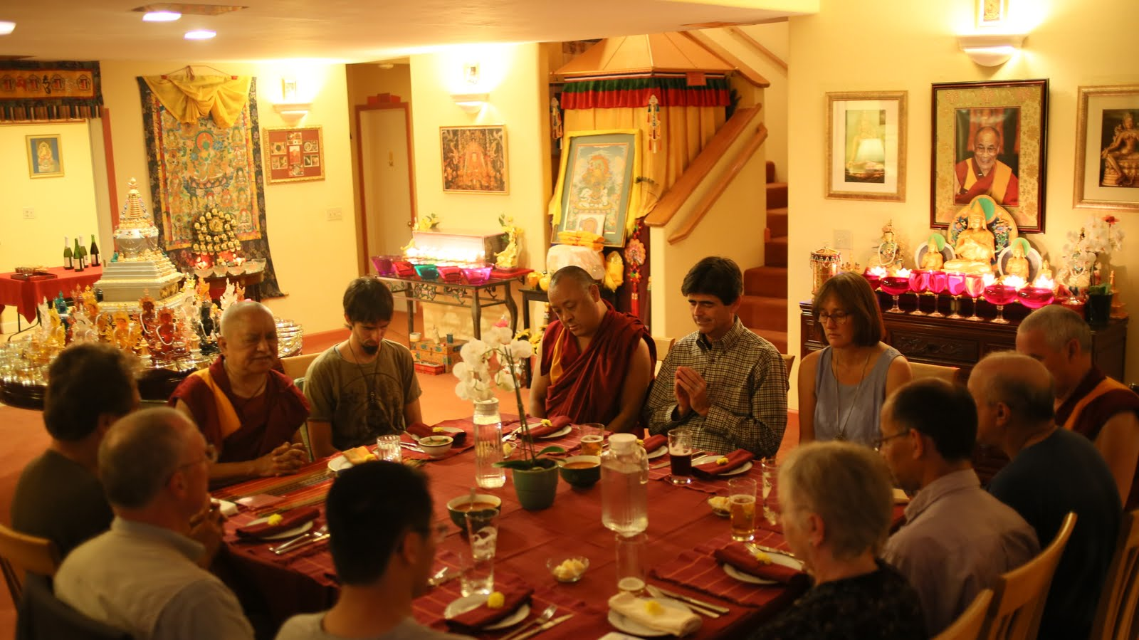 Rinpoche enjoying a meal with the FPMT Board of Directors and guests. September, 2013. Aptos, California. Photo by Ven. Thubten Kunsang.