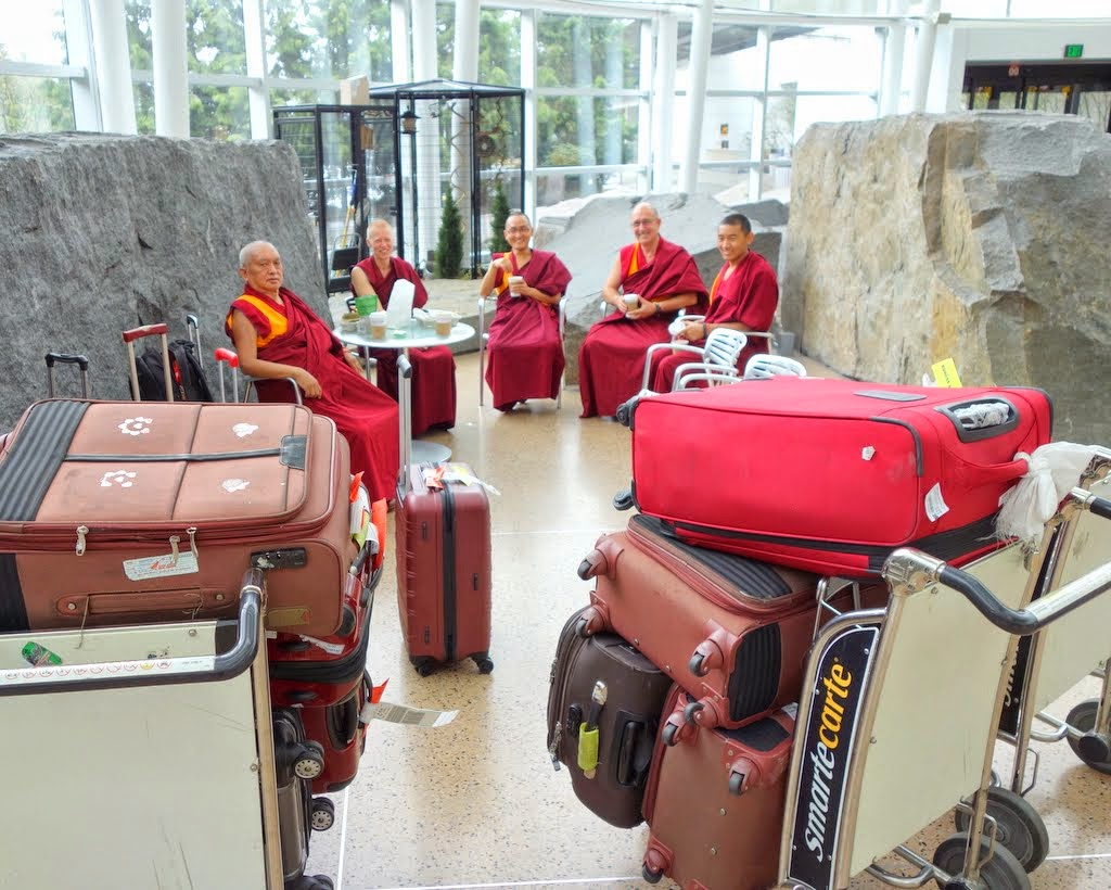 Lama Zopa Rinpoche with Vens. Holly Ansett, Sherab, Kunsang and Sangpo and luggage, after arriving in the United States from Taiwan, SeaTac Airport, Washington, April 2014. Photo by Ven. Roger Kunsang. Ven. Holly drove up from California to meet Rinpoche and his entourage at the airport.