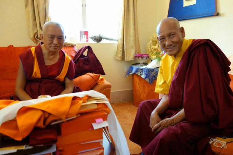 Lama Zopa Rinpoche with the attendant of the previous Khunu Lama Rinpoche, Bodhgaya, India, March 2014. Photo by Ven. Roger Kunsang.