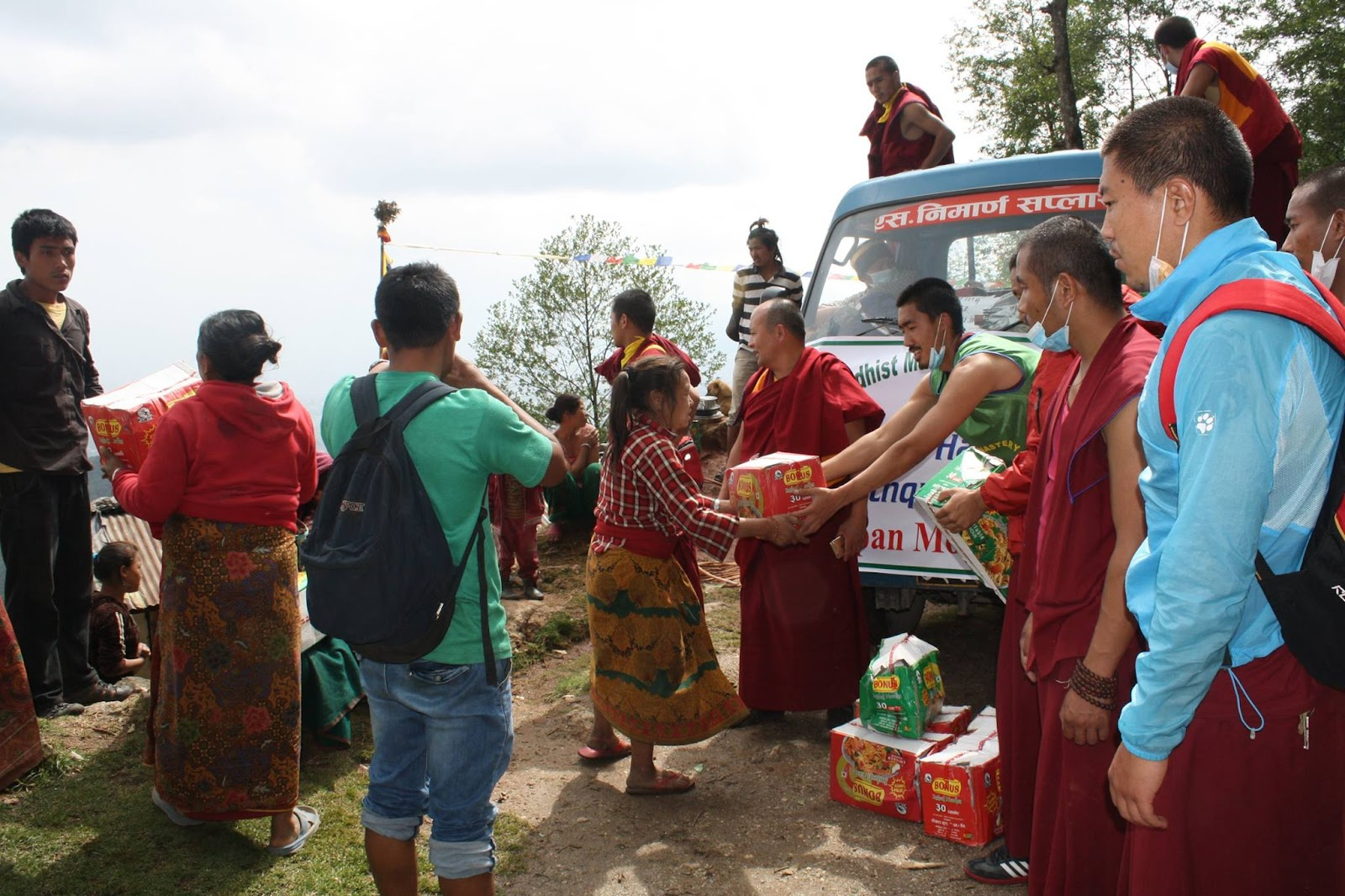 Kopan monks delivering supplies to families in need in the Kathmandu area, Nepal, 30 April 2015.