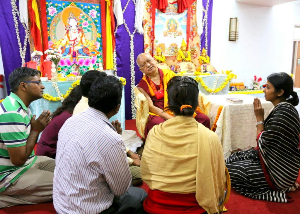 After the White Tara initiation a few of the Indian students requested refuge. Lama Zopa Rinpoche immediately accepted and gave on the spot, Bangalore, India, March 2014. Photo by Ven. Thubten Kunsang.