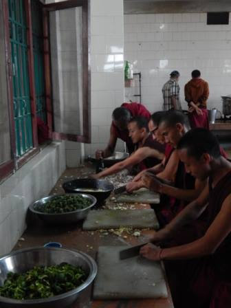 Kopan Monastery monks and staff help prepare food aid for earthquake victims, Kopan, Nepal, April 2015. Photo via Facebook, Kopan Monastery School.