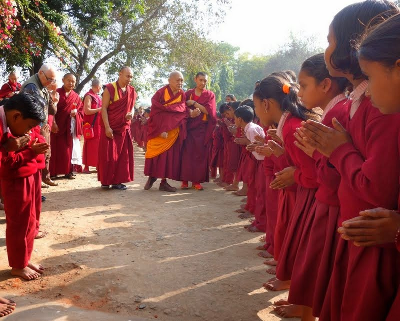 Lama Zopa Rinpoche being greeted by the children of the Maitreya School at Root Institute, January 2014. Photo by Ven. Roger Kunsang.